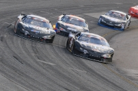 Kyle Busch Motorsports teammates Raphael Lessard (51) and eventual winner Noah Gragson (18) battle for the lead in the early moments. (David Kranak/ Impact Zone Photos)
