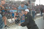 Pensacola native Logan Boyett, who qualified sixth, enjoys some time with fans before the race. (Jim Carson photo)