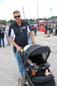 Fred Nason, who owns Nason's Landscaping which is a longtime sponsor of racing in and around northern Illinois, pushes his grandson through the infield. This was the first Five Flags Speedway visit for Fred and his son Austin Nason, who competed in his first Derby. (Jim Carson photo)