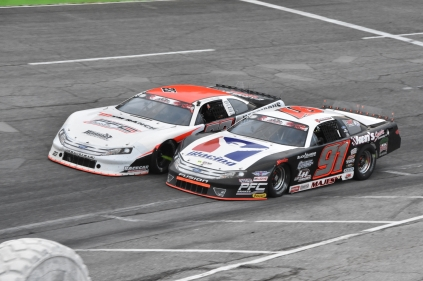 Ty Majeski (91) and Bubba Pollard (26), arguably the two biggest names in pavement Super Late Model racing over the last few years, fight for position. (Kim Kemperman photo)