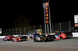 Ty Gibbs (17) and eventual winner Derek Kraus (16) take a late restart up front in the NASCAR K&N Pro East Series race ahead of Colin Garrett (18) and Brandon McReynolds. (Kim Kemperman photo)