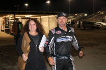 Former Late Model driver and current modified racer Ricky Moxley finishes an order from Brooke Jones, the wife of longtime track photographer and Speedweeks fixture Jim Jones.