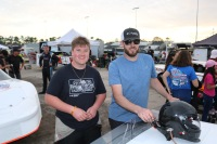 Pro Late Model rookie Austin MacDonald (left) prepares for a race with King Racing crew chief Andrew Hicken.