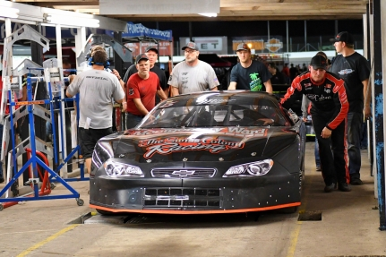 Jeremy Miller pushes his car through part of the tech line. Miller won two Pro Late Model races but had one taken away because of a body panel measurement violation. (Kim Kemperman photo)