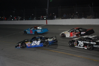 Chance Jewels spins to the inside of the half-mile as Jerick Johnson (76), two-time Pro Late Model podium finisher Loris Hezemans (5) and Dalton Smith speed past him. (Mike Lysakowski/ Motorsport Aspects)