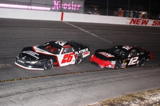 Travis Braden gets loose in front of Super Late Model Orange Blossom 100 winner Derek Griffith. (Mike Lysakowski/ Motorsport Aspects)