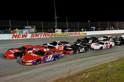 Jett Motorsports teammates Tate Fogleman and Jett Noland take a restart from the front row of the Super Late Model Orange Blossom 100. (Kim Kemperman photo)