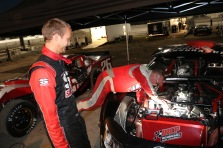 Travis Braden watches his car owner Bill Burba make an adjustment on his Super Late Model. Burba also drove in the modified class.