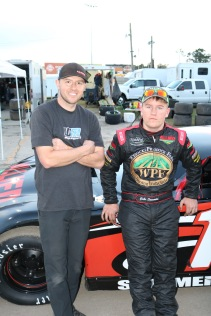 Wisconsin teenager Gabe Sommers (right), the Super Late Model points runner-up, debriefs after qualifying with his adviser for the week, Travis Sauter.