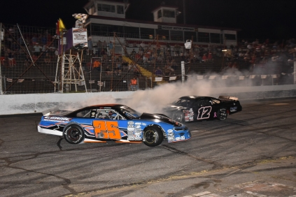 Page 6 (track report; Sherri Stearns Photography & Graphic Design) last lap of the June 29 LMSC nightcap at Hickory Motor Speedway; Kevin Leicht (25) and Austin McDaniel (12)