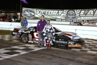 Orange Blossom Super Late Model 100 race winner Ty Majeski is joined by Andrew Hart, the son of track owner Robert Hart (Michael Fettig/Action Shots Photography)